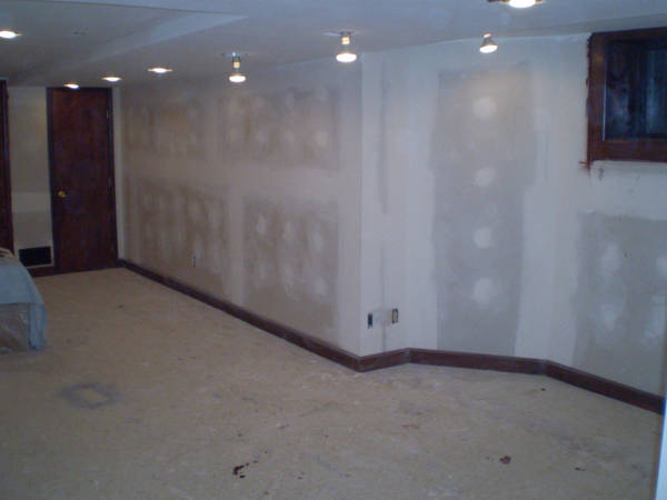 Drywall Dust Is Kicking Up A Lot Of Orbs. We Stained And Varnished The  Existing Cabinets. The Covered Couch Is A Black Leather Deal We Ran Across  At Big ...