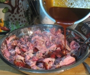 thumb1_adding_bbq_sauce_to_pulled_pork_feb_2014-62227